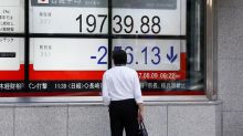 Asia stocks edge lower, focus turns to China markets after ratings cut