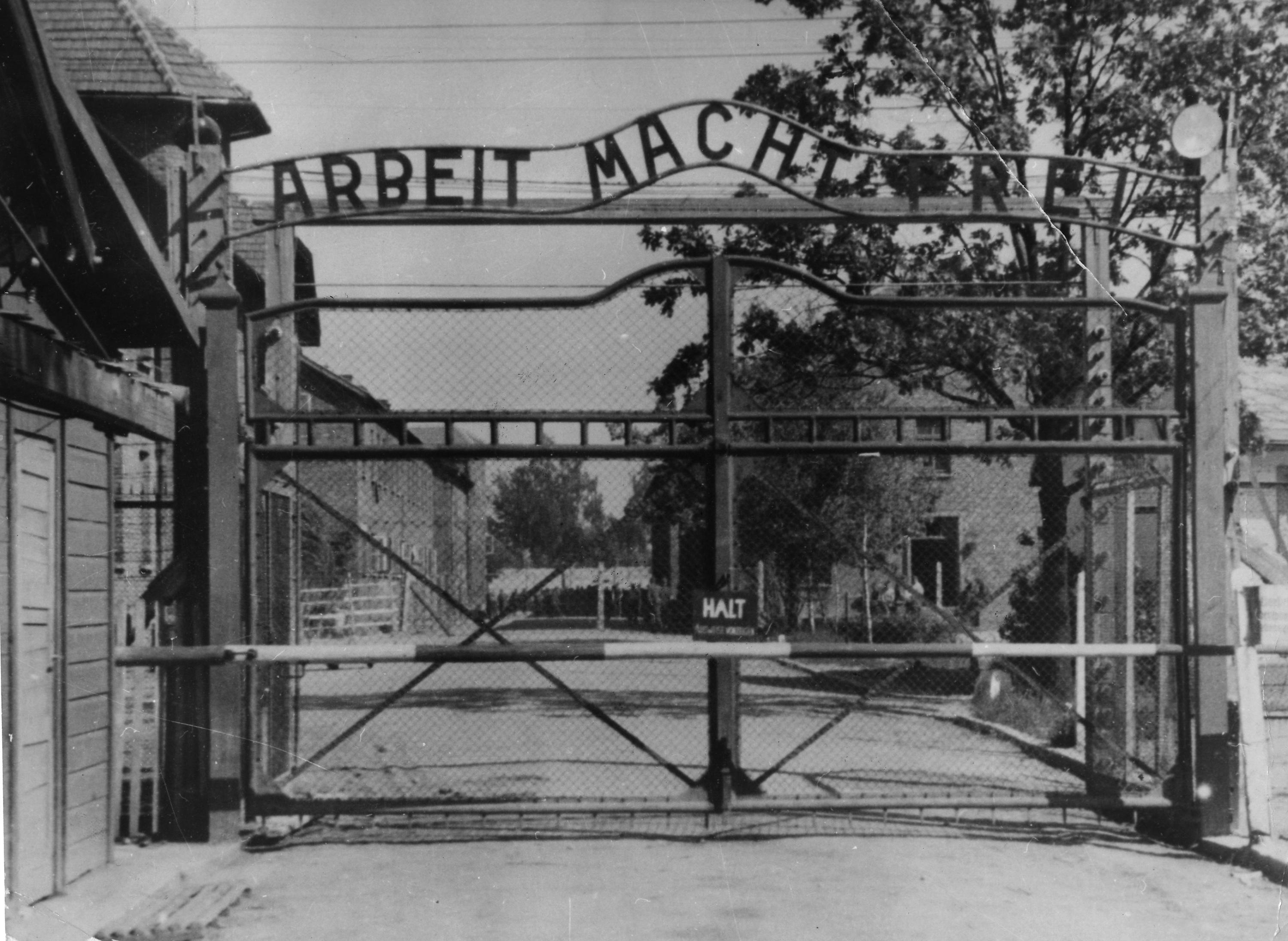 """FILE - This undated file image shows the main gate of the Nazi concentration camp Auschwitz I in Poland, which was liberated by the Russians in January 1945. Writing over the gate reads: """"Arbeit macht frei"""" (Work Sets You Free). Germany has launched a war crimes investigation against an 87-year-old Philadelphia man it accuses of serving as an SS guard at the Auschwitz death camp, The Associated Press has learned, following years of failed U.S. Justice Department efforts to have the man stripped of his American citizenship and deported. Johann """"Hans"""" Breyer, a retired toolmaker, admits he was a guard at Auschwitz during World War II, but told the AP he was stationed outside the facility and had nothing to do with the wholesale slaughter of some 1.5 million Jews and others behind the gates. (AP Photo/File)"""