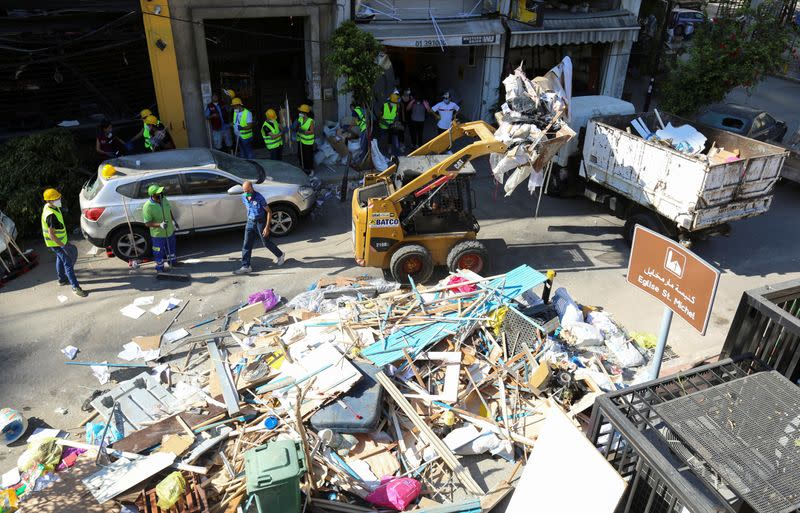 A machine cleans debris at a damaged site following Tuesday's blast in Beirut's port area