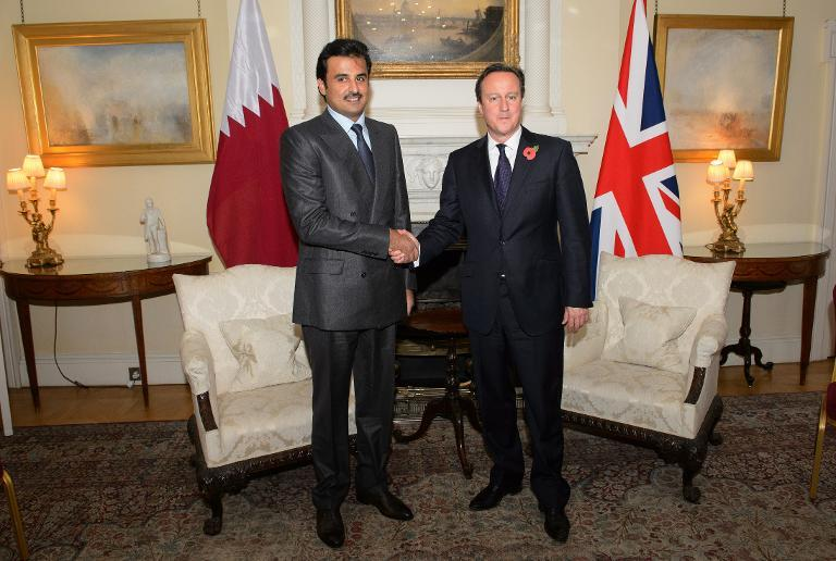 British Prime Minister David Cameron (R) meets with the Emir of Qatar Sheikh Tamim Bin Hamad Al Thani inside 10 Downing Street in London, on October 29, 2014