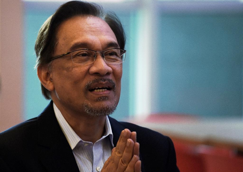 Anwar Ibrahim is newly installed Prime Minister Mahathir Mohamad's former nemesis turned ally (AFP Photo/Manan VATSYAYANA)