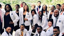 Doctors-to-be celebrate, after weathering 2 hurricanes