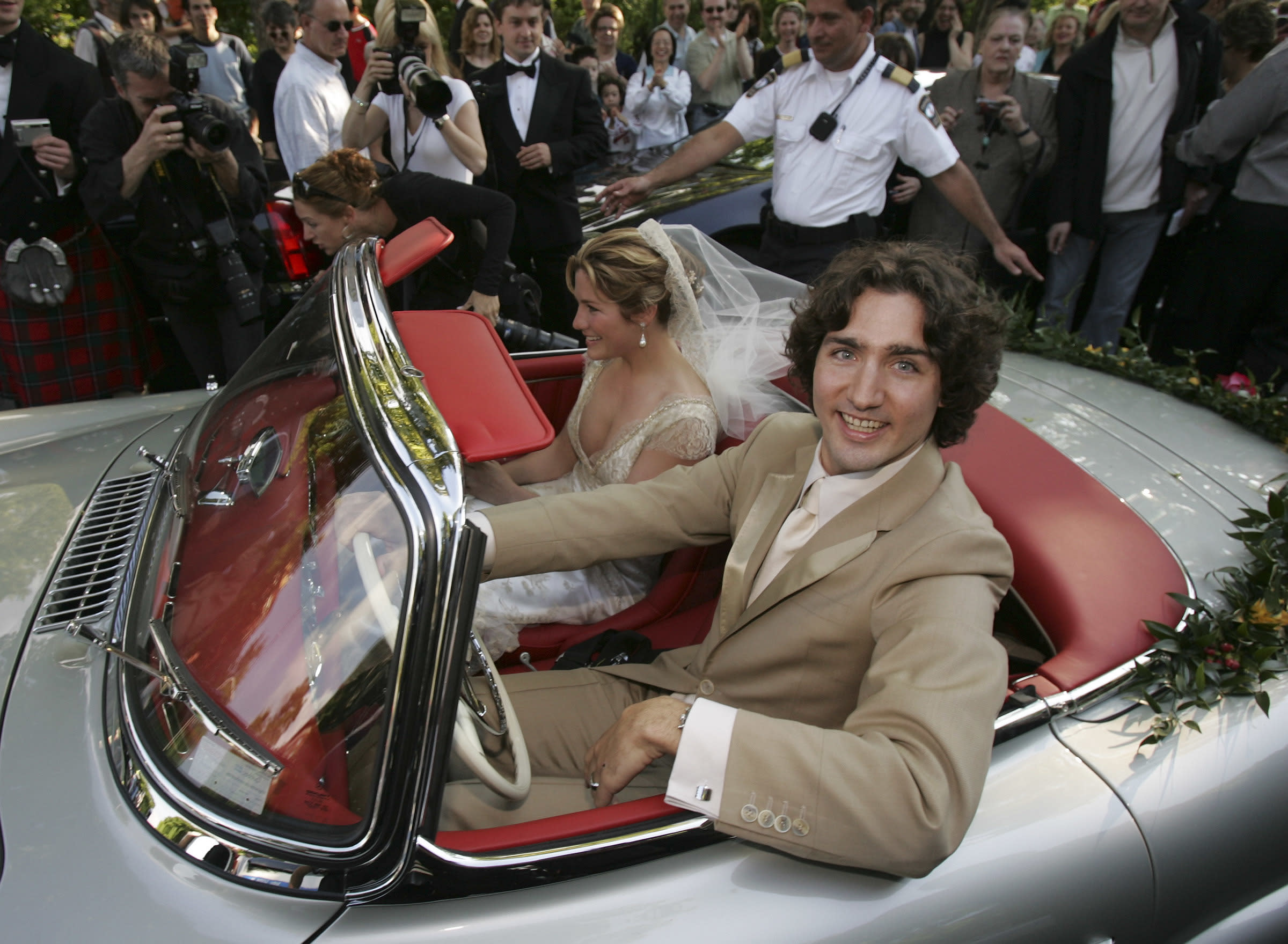 <p>Justin Trudeau and bride Sophie Gregoire leave the Sainte-Madeleine D'Outremont Church, Montreal, after their wedding ceremony here, May 28, 2005. The car a 1959 Mercedez 300SL, was Pierre Trudeua's car and was recently renovated and given its original silver grey colour.</p>  <p>(Bernard Weil/Toronto Star via Getty Images)</p>