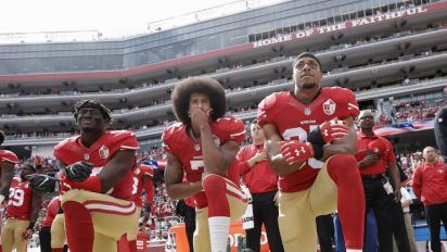 QB's teammates won't kneel for anthem in '17