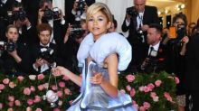 Zendaya channels Cinderella at Met Gala by leaving her glass slipper on pink carpet