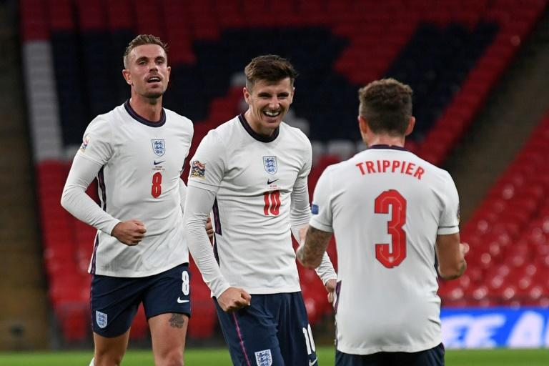 Winning smile: Mason Mount (centre) scored England's second as they beat Belgium 2-1