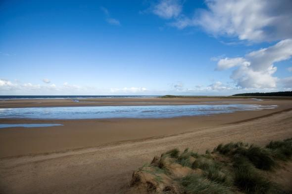 "<p>One of the most unspoilt and stunning stretches of sand in the country, <a href=""http://www.holkham.co.uk/nature-reserve-beach/the-beach/introduction"" target=""_blank"">Holkham Beach</a> is delightful in the summer, with its four miles of golden sands, grassy dunes and maze of creeks. Behind the shoreline lies a basin which rapidly fills at very high tides and forms a spectacular shallow lagoon. Dogs on leads are welcome at the beach and horse riding is permitted too. <strong>Best for: Animal loving families.</strong></p>"