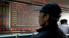 Hong Kong stocks pull Asian shares lower but futures offer hope