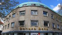 Danske Bank sees profit at lower end of range as money laundering probes continue