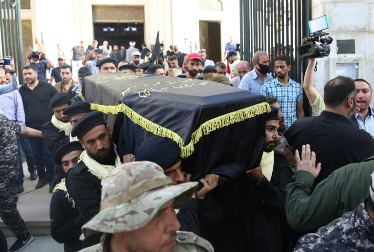 Mourners carry the coffin of Shalah during his funeral in the Syrian capital Damascus on June 7, 2020 (AFP Photo/STR)