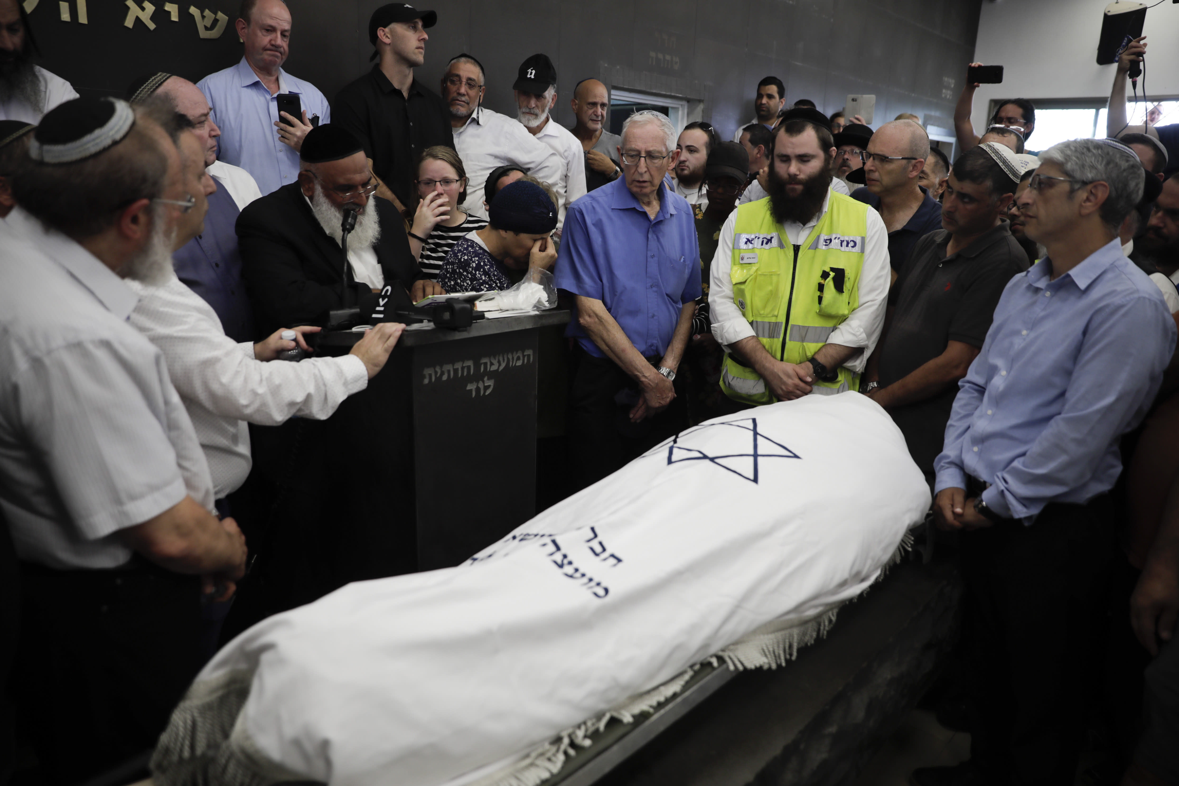 People attend the fineral of 17 year opld Rina Shnerb, in Lod, Israel, Friday, Aug. 23, 2019. Shnerb has died of wounds from an explosion in the West Bank that the Israeli military has described as a Palestinian attack. (AP Photo/Sebastian Scheiner)