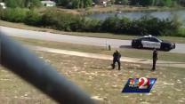 Raw video: Deputy wrestles alligator outside school