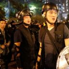 Hong Kong police arrest 29 after clashes as protesters regroup in the rain