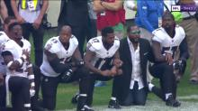 Jaguars owner, Ravens players, coaches among those who join arms during anthem