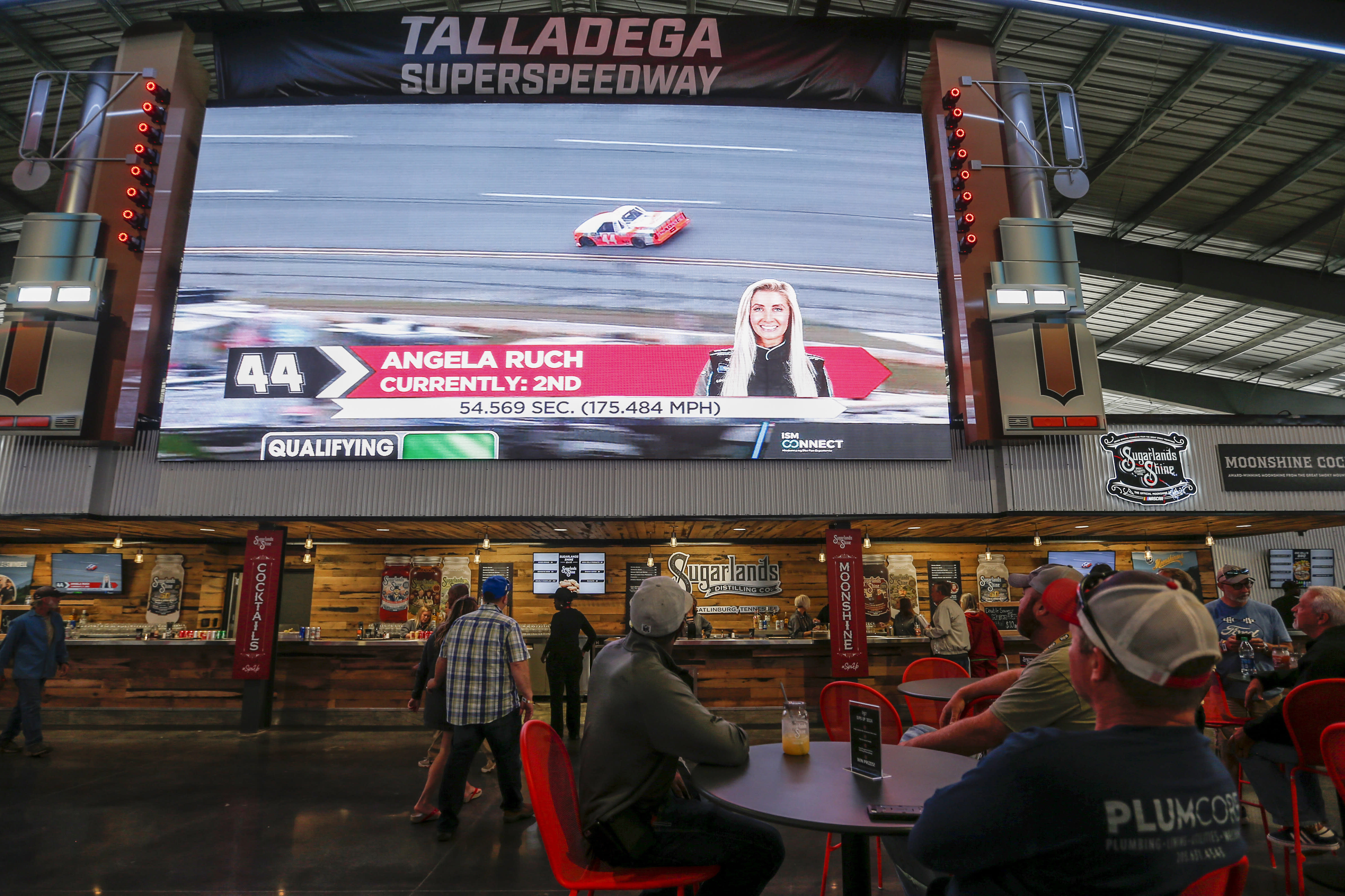 Fans explore the new facilities and garages at Talladega Superspeedway, Saturday, Oct. 12, 2019, in Talladega, Ala. (AP Photo/Butch Dill)