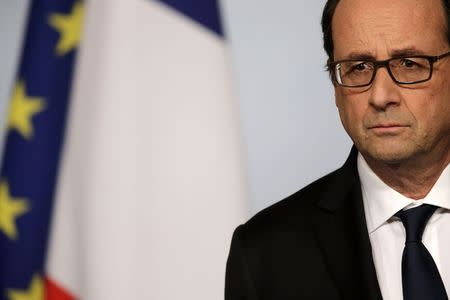 French President Hollande attends a news conference at the Elysee Palace in Paris