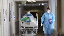 Outbreak at Washington food plant puts halt to reopening plan