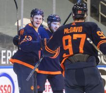 McDavid's late goal, 2 assists send Oilers past Flames 3-2
