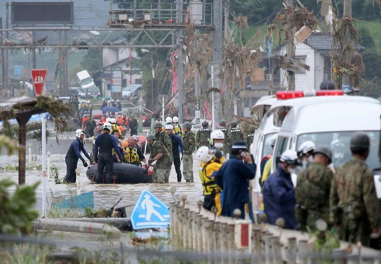 Rescuers are searching for 14 people missing after floods hit the Kumamoto region on Japan's southwestern island of Kyushu (AFP Photo/STR)