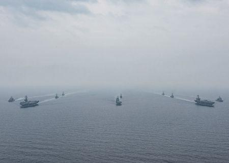 U.S. Navy aircraft carriers USS Ronald Reagan (front) and USS Carl Vinson and (back R) sail with their strike groups and Japanese naval ships JS Hyuga (C) and JS Ashigara during training in the Sea of Japan, June 1, 2017. U.S. Navy/Mass Communication Specialist 2nd Class Z.A. Landers/Handout via REUTERS