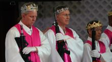 The meaning behind the crowns and robes worshipers wore during an AR-15 blessing ceremony