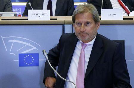 European Neighbourhood Policy and Enlargement Negotiations Commissioner-designate Hahn of Austria arrives at the European Parliament's Committee on Foreign Affairs in Brussels