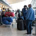 COVID-19 and travel: As airports are packed across the U.S., experts warn of 'a surge' of new cases after Thanksgiving