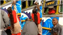 Beating the Crowd: Man Shoves Wife in Head-First Through Window of Cramped Bus in West Bengal