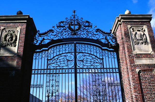 Harvard closed its gates to at least 10 admitted applicants who traded insensitive memes on a Facebook messaging group. (Kim Grant via Getty Images)