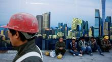 China's migrant workers fall in number as economy slows