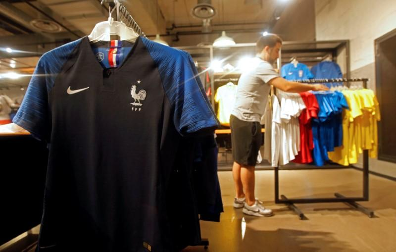 wholesale dealer fe20b 3f492 France team soccer jerseys are displayed in a sporting goods store in  Marseille