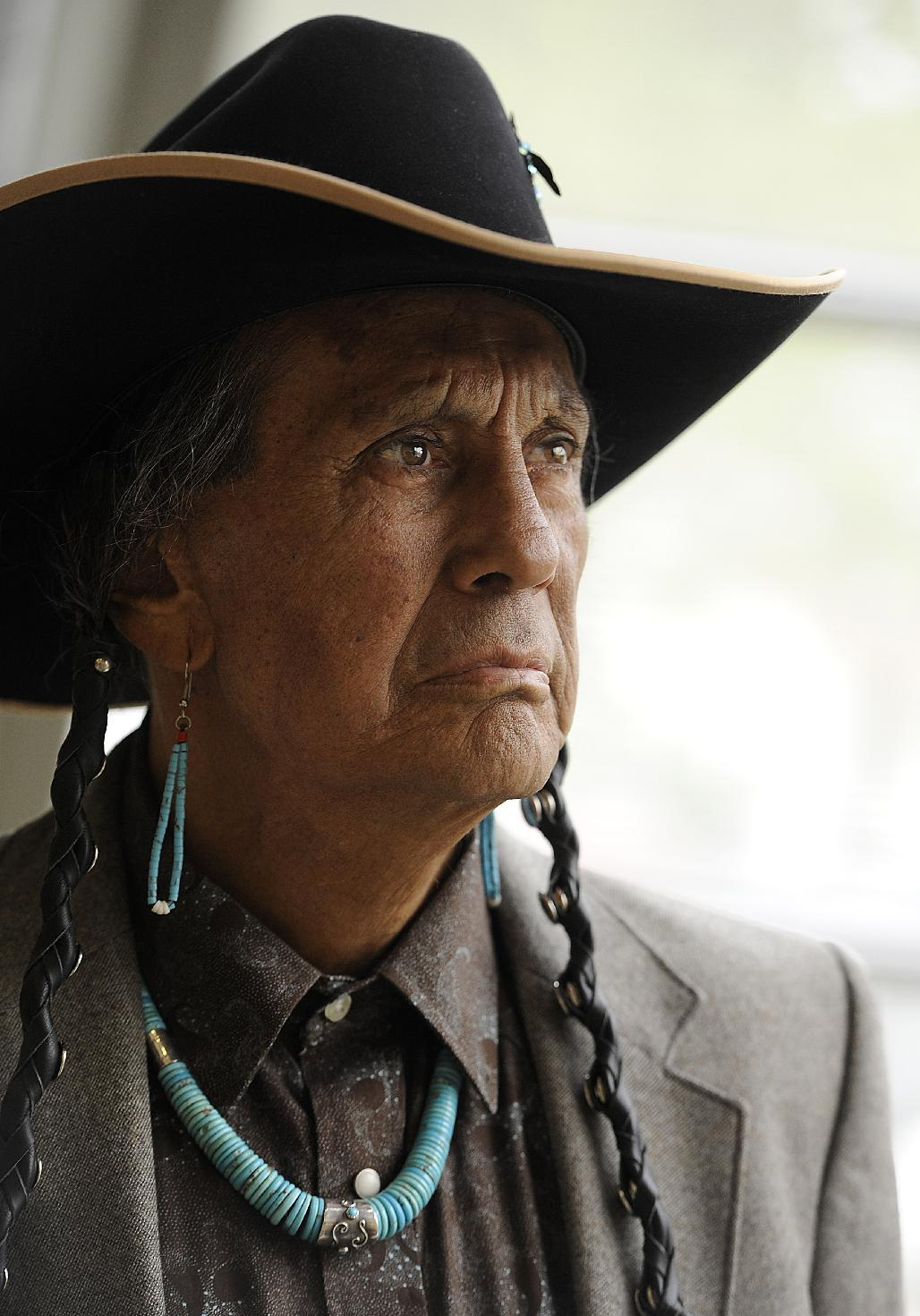 FILE - In a Friday, April 27, 2012 file photo, Russell Means, former leader of the American Indian Movement, (AIM) poses for a portrait at Augustana College in Sioux Falls, S.D. Means, a former American Indian Movement activist who helped lead the 1973 uprising at Wounded Knee, reveled in stirring up attention and appeared in several Hollywood films, died early Monday, Oct. 22, 2012 at his ranch in in Porcupine, S.D., Oglala Sioux Tribe spokeswoman Donna Solomon said. He was 72. (AP Photo/Argus Leader Jay Pickthorn) NO SALES