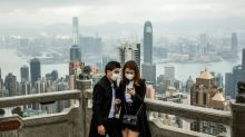 Hong Kong to give big cash handouts as economy reels from virus