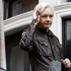 The Latest: AP Source: Sealed charges filed against Assange