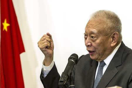 Former Hong Kong Chief Executive Tung Chee-hwa addresses a news conference in Hong Kong