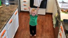 This three-year-old is very proud of himself for covering his kitchen in carrots
