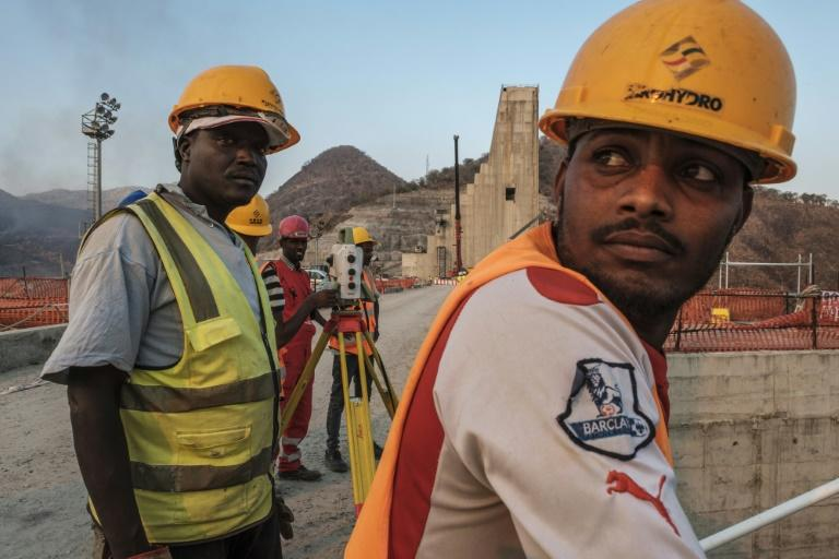 As workers toil to finish the project, Ethiopian negotiators remain locked in talks over how the dam will affect downstream neighbours, principally Egypt (AFP Photo/EDUARDO SOTERAS)