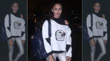 Fashion Culprit Of The Day: Erica Fernandes In White Sweatshirt And Silver Cigarette Jeggings