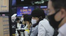 Asian shares mixed despite fresh records on Wall Street