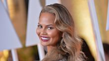 Chrissy Teigen bought five wedding dresses because she 'felt guilty'