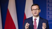 Polish PM says he's told Merkel of plan to veto EU budget