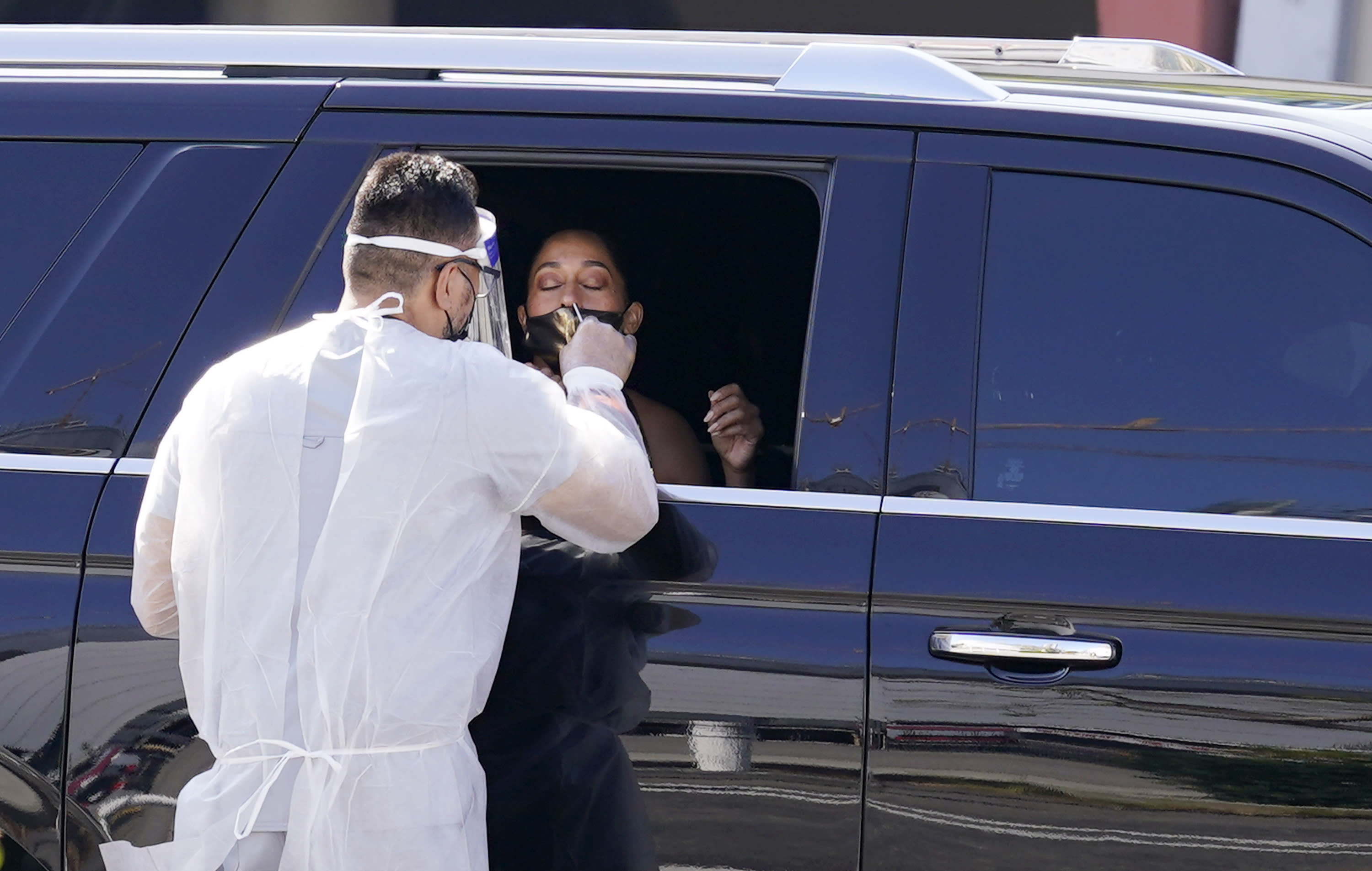 Actress Tracee Ellis Ross gets a coronavirus test as she arrives for the 72nd Primetime Emmy Awards at Staples Center, Sunday, Sept. 20, 2020, in Los Angeles. (AP Photo/Chris Pizzello)