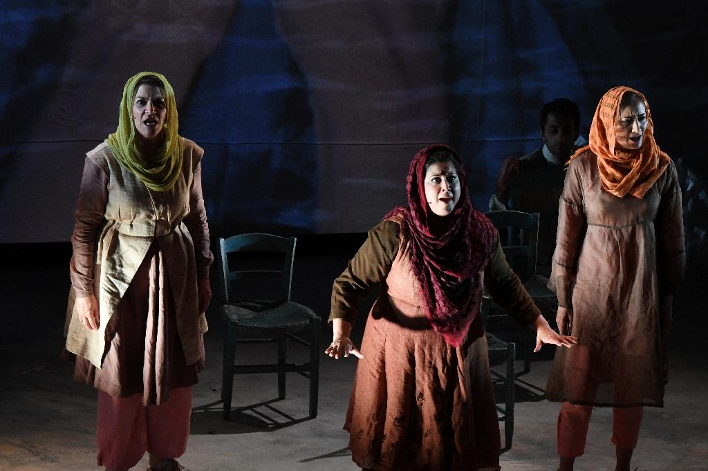 Kamala Sankaram (C) portrays Pakistani women's rights activist Mukhtar Mai in the opera 'Thumbprint', at the Roy and Edna Disney/Calarts Theater (REDCAT) in Los Angeles, on June 16, 2017 (AFP Photo/Robyn Beck)