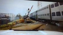 Police video captures near-miss after gate fails at train crossing