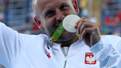 Polish Olympian sells silver medal to billionaire siblings to help boy with a rare form of cancer