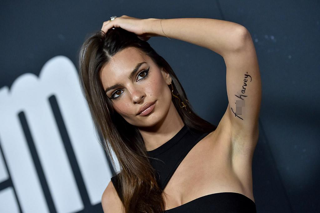 Emily Ratajkowski wears 'F*** Harvey' message to premiere after Weinstein's settlement is revealed