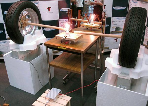 Japanese group transmits electricity through 4-inch concrete block, could power cars on roads