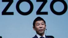 Japanese fashion tycoon Maezawa shows off $900 million SoftBank payday