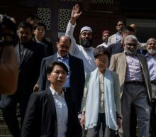 Hong Kong leader visits mosque struck by blue water-cannon dye