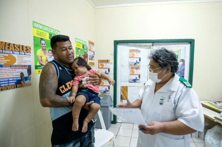 An immunisation drive has boosted coverage rates from just 30 percent to around 90 percent (AFP Photo/Allan STEPHEN)
